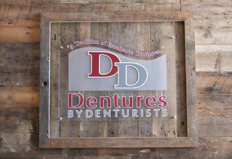 Dentures By Denturists wall logo